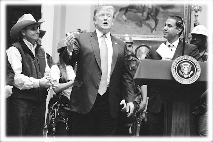 FCC chairman Ajit Pai, right, looks on as President Trump delivers remarks on 5G technology during a White House event on April 12. (Photo: Evan Vucci/AP, digitally enhanced by Yahoo News)
