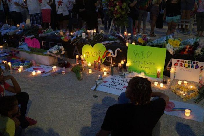 Candles and posters are placed in honor of the Pulse shooting victims during a vigil outside the Dr. Phillips Center for the Performing Arts in downtown Orlando on June 13, 2016. (Photo: Michael Walsh/Yahoo News)