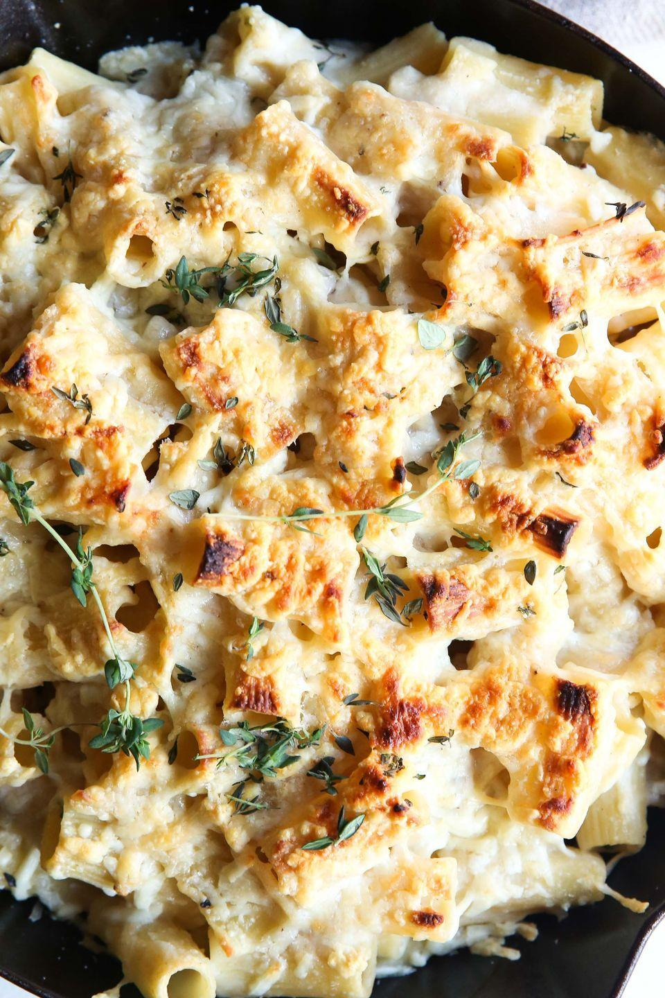 """<p>When it's cold outside, creamy pastas are the only thing that'll do.</p><p>Get the recipe from <a href=""""/cooking/recipe-ideas/recipes/a50893/baked-creamy-garlic-rigatoni-recipe/"""" data-ylk=""""slk:Delish"""" class=""""link rapid-noclick-resp"""">Delish</a>.</p>"""