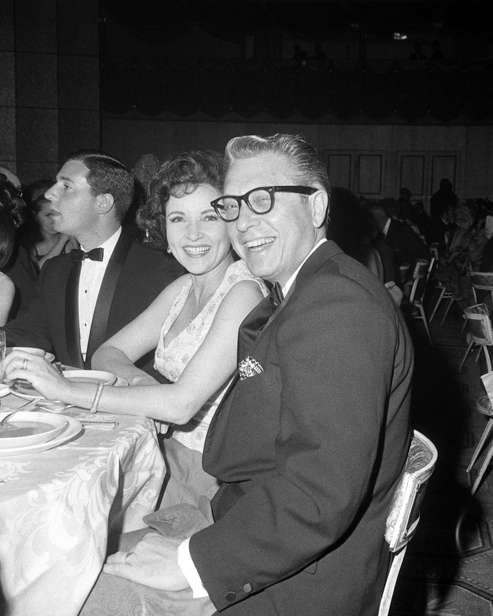 "<p>White and her husband, Allen Ludden, enjoy the 18th annual Emmy Awards in Hollywood, California. Throughout her <a href=""https://www.emmys.com/bios/betty-white"" rel=""nofollow noopener"" target=""_blank"" data-ylk=""slk:lengthy career"" class=""link rapid-noclick-resp"">lengthy career</a>, she has received 21 Emmy nominations, winning the gold five times. </p>"