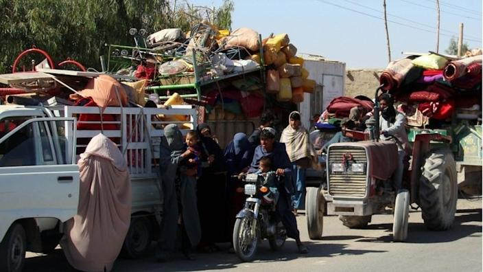Afghans flee their villages after fighting intensified between Taliban militants and security forces, in Lashkargah, the provincial capital of restive Helmand province, Afghanistan, 12 October 2020.