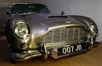 "An Aston Martin DB5 from the James Bond film ""Goldfinger"" is displayed at the opening of the ""Bond in Motion: 50 Vehicles 50 Years"" exhibition at the National Motor Museum in Beaulieu, southern England January 15, 2012. REUTERS/Suzanne Plunkett"