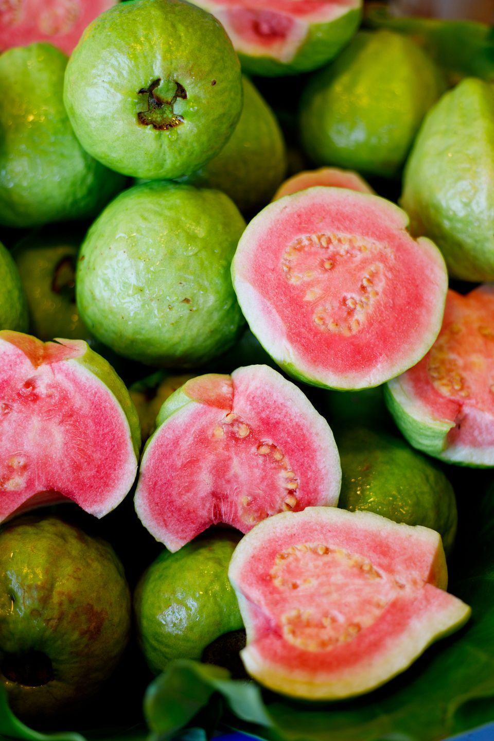 """<p>Give your immune system a boost with guava. They're rich in vitamin C, <a href=""""https://www.goodhousekeeping.com/health/diet-nutrition/g2065/potassium-superfoods/"""" rel=""""nofollow noopener"""" target=""""_blank"""" data-ylk=""""slk:potassium"""" class=""""link rapid-noclick-resp"""">potassium</a> and fiber, and have a fair amount of folate. With a tropical tang, guavas can be used to make a tasty jam, or turned into a syrup or glaze to use in a host of recipes. </p>"""