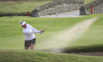 Denmark's Nanna Koerstz Madsen chips out of a bunker on the 18th green during the final round of the Women's British Open golf championship, in Carnoustie, Scotland, Sunday, Aug. 22, 2021. (AP Photo/Scott Heppell)