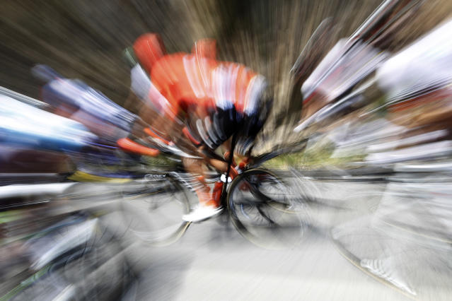 In this slow motion picture a rider pedals in the pack during the tenth stage of the Tour de France cycling race over 217 kilometers (135 miles) with start in Saint-Flour and finish in Albi, France, Monday, July 15, 2019. (AP Photo/ Christophe Ena)