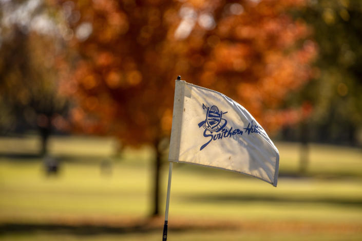A detailed view of a pin and flag at Southern Hills Country Club
