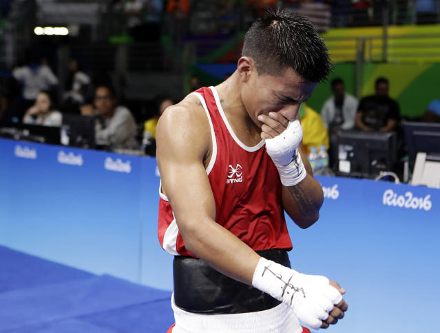 <p>Ecuador's Carlos Eduardo Quipo Pilataxi cries as he walks off after losing a match against United State's Nico Miguel Hernandez during a men's light flyweight 49-kg quarterfinals boxing match at the 2016 Summer Olympics in Rio de Janeiro, Brazil, Wednesday, Aug. 10, 2016. (AP Photo/Frank Franklin II) </p>