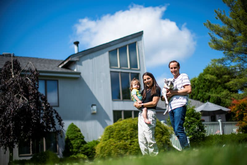 Stephanie Ellis her son Nolan and her husband Paul pose for a picture at her home in Marlboro, New Jersey