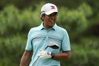 Juvic Pagunsan, of the Philippines, watches his shot from the 12th tee during the first round for the men's golf event at the 2020 Summer Olympics, Thursday, July 29, 2021, at the Kasumigaseki Country Club in Kawagoe, Japan, (AP Photo/Matt York)