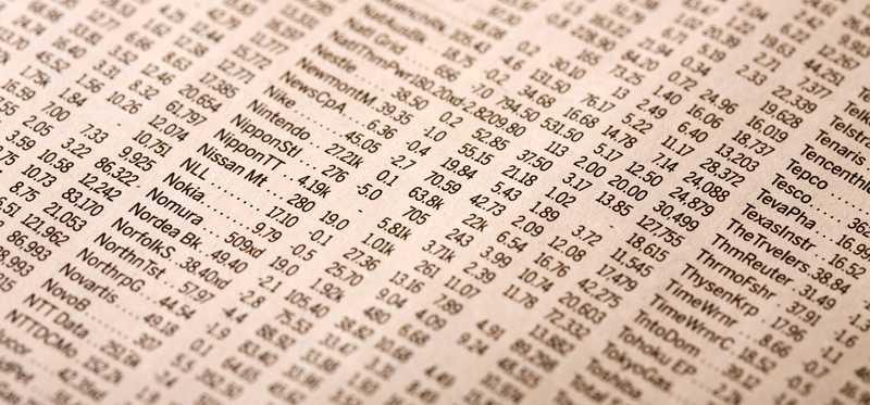 Newspaper page showing stock prices.