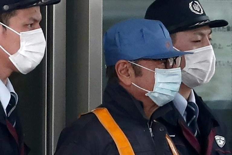 Ghosn attempted to give media the slip when he left the detention centre in a workers' uniform