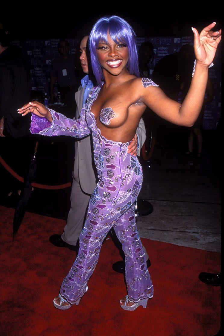 Lil Kim rocks her infamous 1999 VMAs look. (Photo: Getty Images)