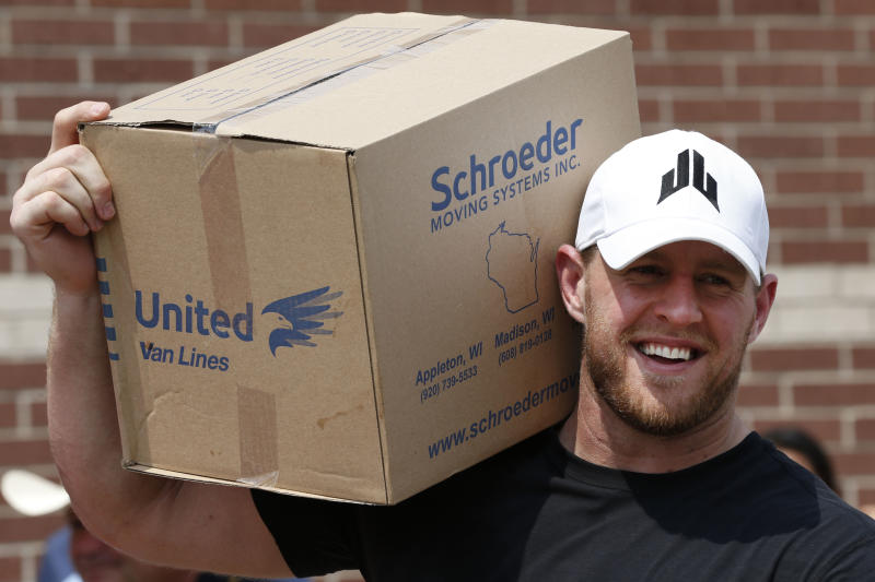HOUSTON, TX - SEPTEMBER 3: (AFP OUT) Houston Texans defensive end J.J. Watt holds a box of relief supplies on his shoulder while handing them out to people impacted by Hurricane Harvey on September 3, 2017, in Houston, Texas. Watt's Hurricane Harvey Relief Fund has raised more than $18 million to date to help those affected by the storm. (Photo by Brett Coomer - Pool/Getty Images)