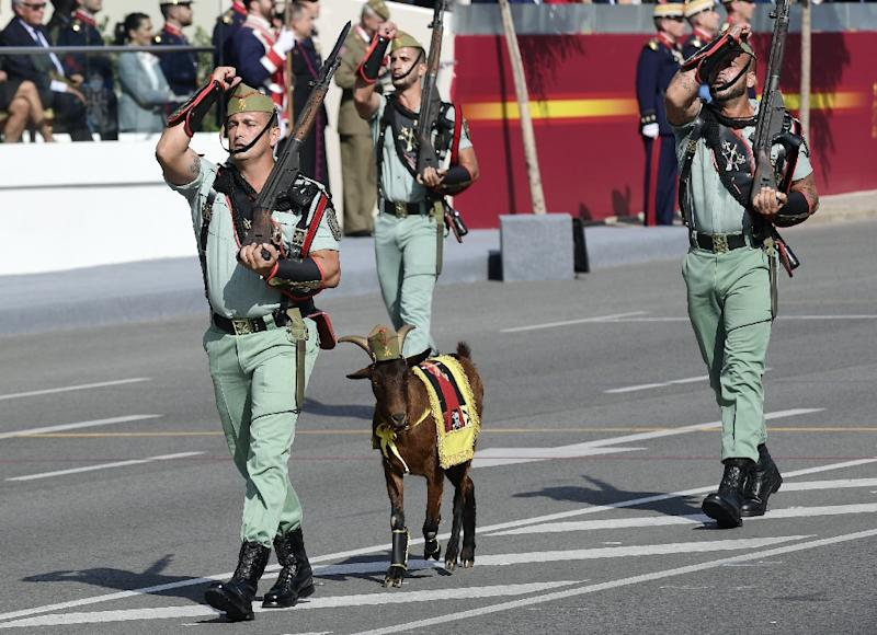 Legionnaires and their goat mascot march during the Spanish National Day military parade in Madrid on October 12, 2017 (AFP Photo/JAVIER SORIANO)