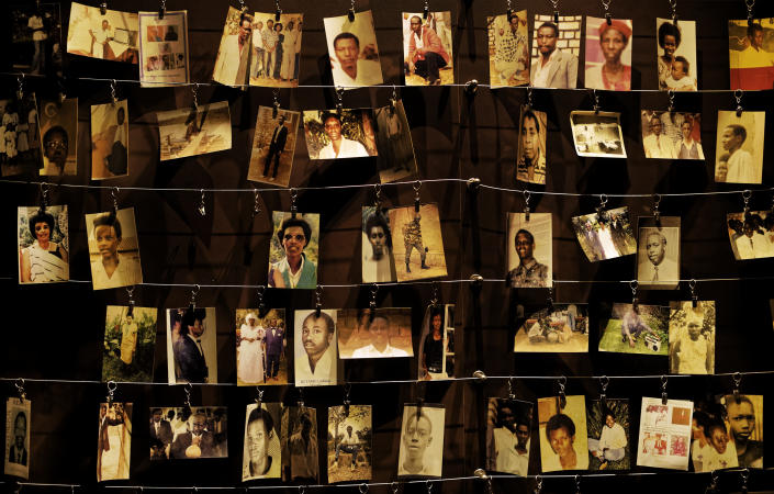 FILE - In this Friday, April 5, 2019 file photo, family photographs of some of those who died hang on display in an exhibition at the Kigali Genocide Memorial centre in the capital Kigali, Rwanda. France and Rwanda are hoping to reset ties scarred by a quarter century of recriminations over the 1994 Rwandan genocide when French President Emmanuel Macron visits the central African country. (AP Photo/Ben Curtis, File)