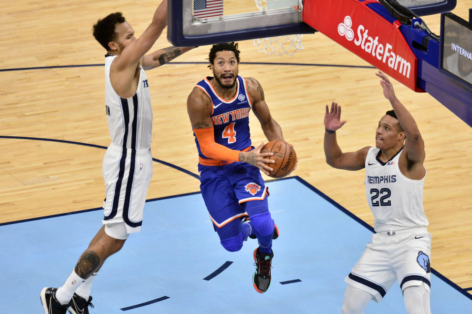 New York Knicks guard Derrick Rose (4) jumps to shoot between Memphis Grizzlies guard Desmond Bane (22) and forward Kyle Anderson in the second half of an NBA basketball game Monday, May 3, 2021, in Memphis, Tenn. (AP Photo/Brandon Dill)