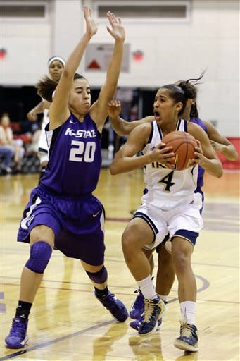 Notre Dame's Skylar Diggins, right, drives to the lane against Kansas State's Bri Craig during the first half of an NCAA college basketball game, Thursday, Dec. 20, 2012, in Las Vegas. (AP Photo/Julie Jacobson)