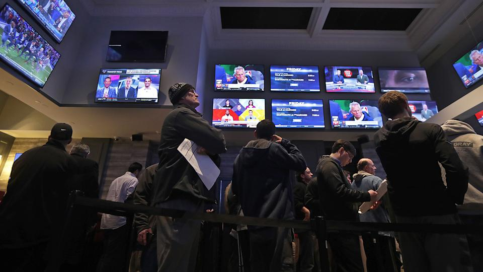 LINCOLN, RI - JANUARY 29: People line up to place bets at the sports book bar at Twin River Casino in Lincoln, RI on Jan. 29, 2019. (Photo by Barry Chin/The Boston Globe via Getty Images)