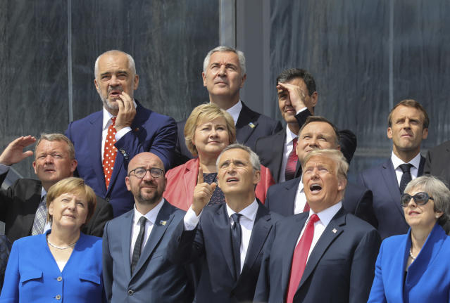 <p>From bottom row left: German Chancellor Angela Merkel, Belgian Prime Minister Charles Michel, NATO Secretary-General Jens Stoltenberg, U.S. President Trump, British Prime Minister Theresa May; second row from the left: Danish Prime Minister Lars Lokke Rasmussen, Norwegian Prime Minister Erna Solberg, Polish President Andrzej Duda, French President Emmanuel Macron; third row from left, Albanian Prime Minister Edi Rama, Czech Republic President Milos Zeman and Spanish Prime Minister Pedro Sanchez. The world leaders poses for a group picture ahead of the opening ceremony of the NATO summit in Brussels on July 11, 2018. (Photo: Ludovic Marin, pool via AP) </p>