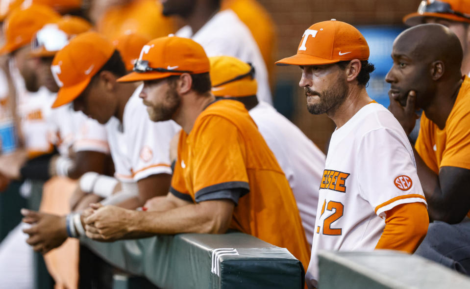 Tennessee head coach Tony Vitello, front right, looks on during an NCAA college baseball super regional game against LSU, Saturday, June 12, 2021, in Knoxville, Tenn. (AP Photo/Wade Payne)