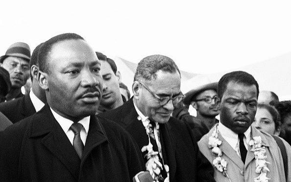 Martin Luther King Jr on the Selma to Montgomery March, in 1965 - Getty
