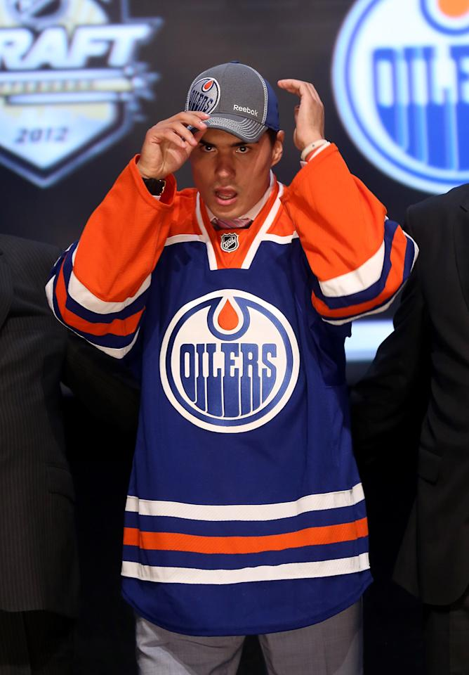 PITTSBURGH, PA - JUNE 22: Neil Yakupov, first overall pick by the Edmonton Oilers, poses onstage during Round One of the 2012 NHL Entry Draft at Consol Energy Center on June 22, 2012 in Pittsburgh, Pennsylvania.  (Photo by Bruce Bennett/Getty Images)