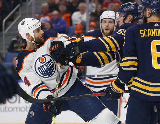 Buffalo Sabres defenseman Rasmus Ristolainen (55) pushes Edmonton Oilers forward Zack Kassian (44) during the first period of an NHL hockey game, Monday, March 4, 2019, in Buffalo N.Y. (AP Photo/Jeffrey T. Barnes)
