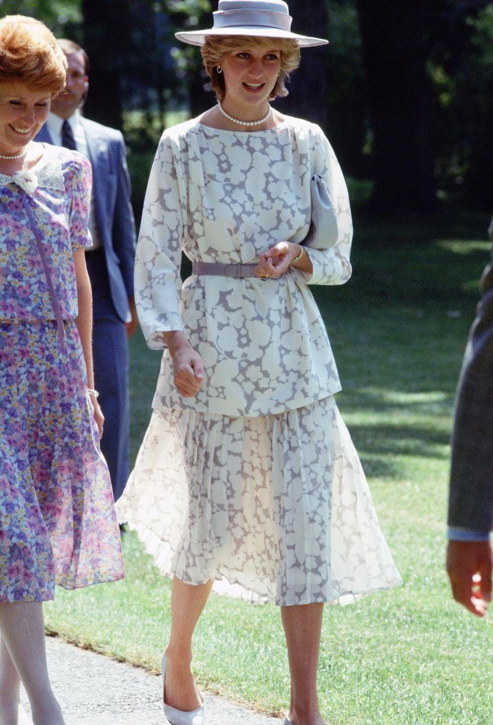 <p>In a suit by Jasper Conran paired with a light purple hat and belt while in Ottawa.</p>