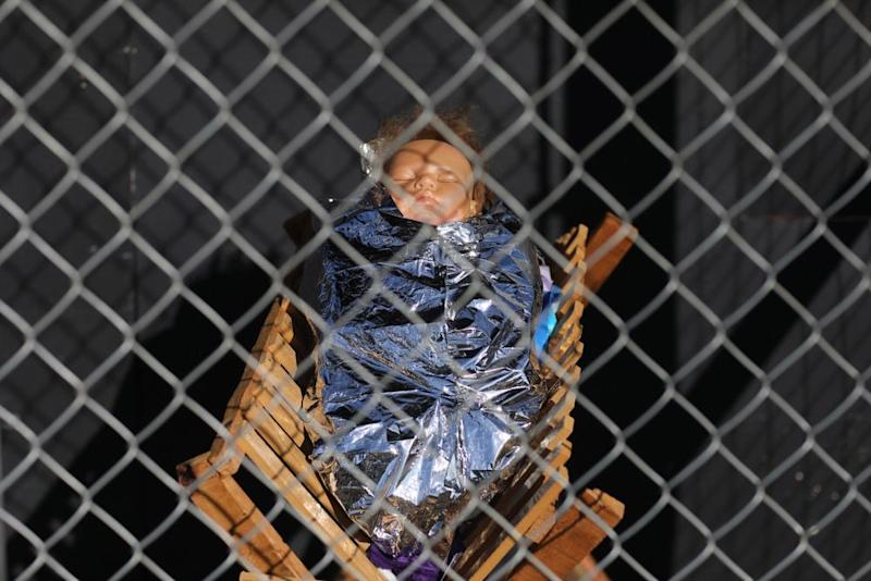 A statue of Baby Jesus in the cage