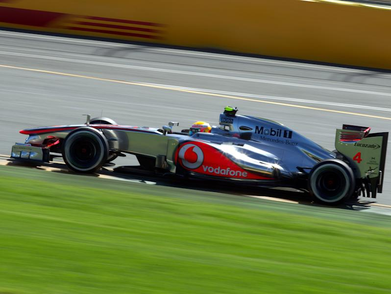 McLaren driver Lewis Hamilton of Britain steers his car during the third practice session for Sunday's Australian Formula One Grand Prix at the Albert Park in Melbourne, Australia, Saturday, March 17, 2012. (AP Photo/John Donegan)