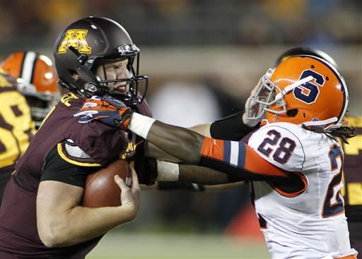 Minnesota quarterback Max Shortell, left, tries to escape from Syracuse linebacker Jeremi Wilkes (28) in the first half of an NCAA college football game in Minneapolis, Saturday, Sept. 22, 2012. (AP Photo/Andy King)