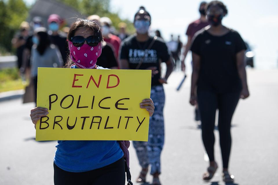 <p>Protesters march in Bridgewater, New Jersey, on 13 June 2020 during a demonstration against police brutality and racism following the murder of George Floyd in Minneapolis on 25 May. </p> ((Photo by NICHOLAS KAMM/AFP via Getty Images))