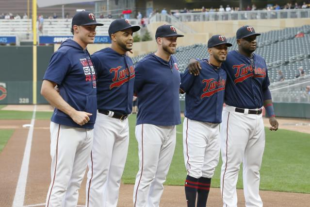 Five Minnesota Twins players are honored for 30-plus home runs each this season, from left: Max Kepler, Nelson Cruz, Mitch Garver, Eddie Rosario and Miguel Sano, pose before a baseball game against the Chicago White Sox Wednesday, Sept. 18, 2019, in Minneapolis. (AP Photo/Jim Mone)