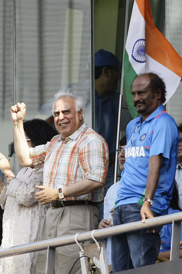 MUMBAI, INDIA - APRIL 02: Union Minister Kapil Sibal and Rajnikanth during the ICC Cricket World Cup 2011 Final match at The Wankhede Stadium in Mumbai on April 2, 2011. India beat Sri Lanka by 6 wickets to lift the cup. (Photo by Naveen Jora/India Today Group/Getty Images)
