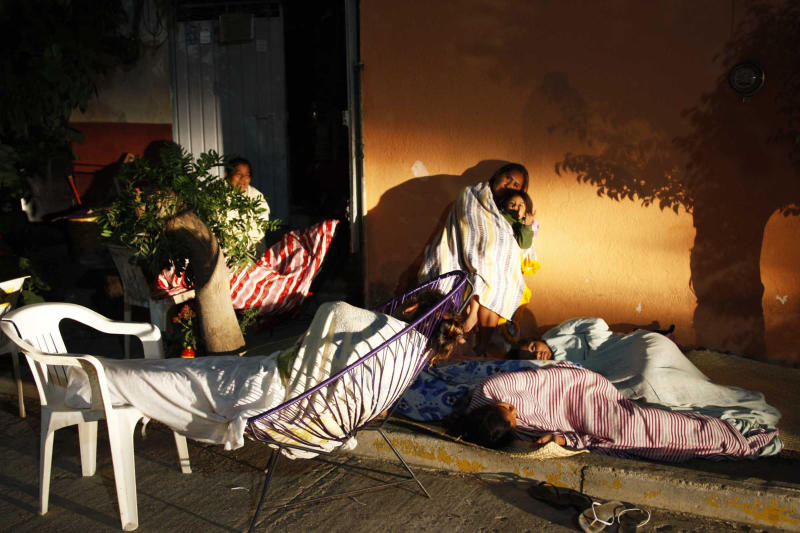 Members of a family sleep outside their home in fear that aftershocks from Tuesday's magnitude-7.4 quake could cause their home to collapse in Pinotepa Nacional, Mexican state of Oaxaca, near the border with Guerrero, Wednesday March 21, 2012. As of early Wednesday, there were no reports of deaths from Tuesday's quake centered near the border between the southern states of Oaxaca and Guerrero, even after 10 aftershocks. (AP Photo/Luis Alberto Cruz Hernandez)