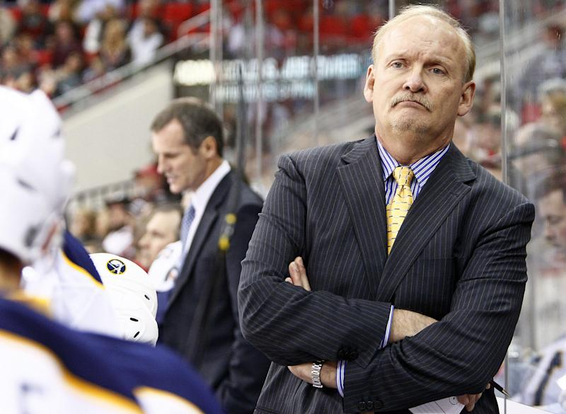 FILE - In this Nov. 18, 2011 file photo, Buffalo Sabres head coach Lindy Ruff watches from behind the bench during the first period of an NHL hockey game against the Carolina Hurricanes in Raleigh, N.C. Ruff has been hired as the new coach of the Dallas Stars. The team announced the hiring on Friday, June 21, 2013. (AP Photo/Karl B DeBlaker, File)