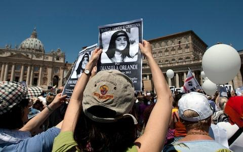 Protesters in St Peter's Square call on the Vatican to release documents relating to Emanuela Orlandi, who vanished in Rome in 1983 - Credit: Andrew Medichini/AP