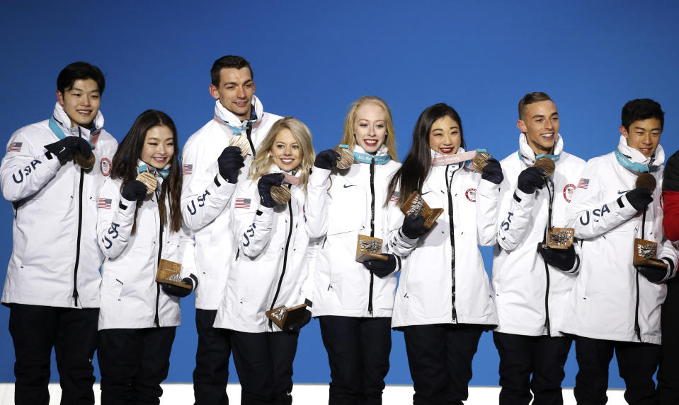 <p>Team figure skating bronze medalists from the United States pose during their medals ceremony at the 2018 Winter Olympics in Pyeongchang, South Korea, Monday, Feb. 12, 2018. (AP Photo/Jae C. Hong) </p>
