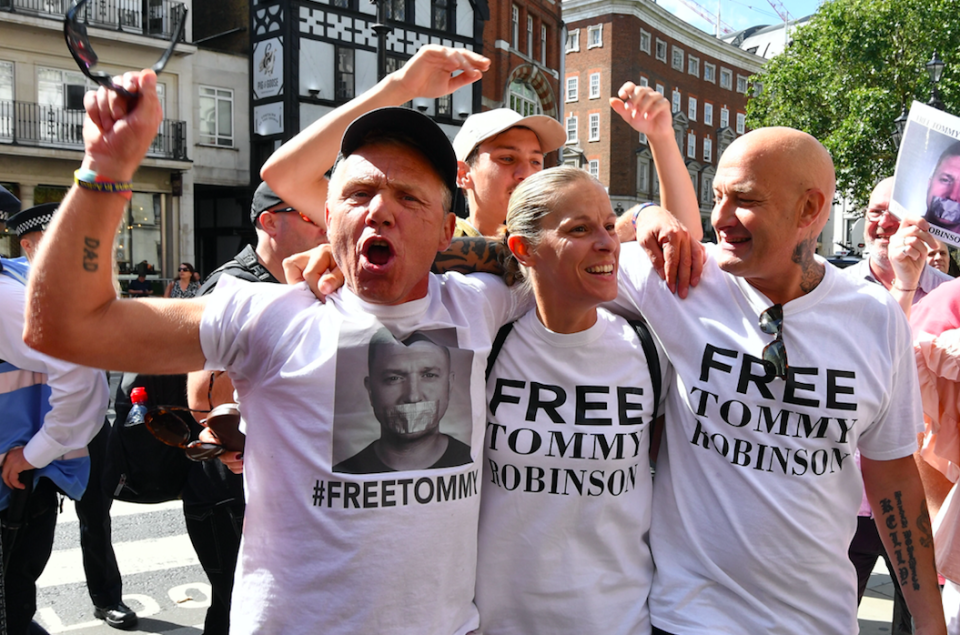 <em>Robinson supporters celebrate after the former EDL leader was freed on bail (PA)</em>