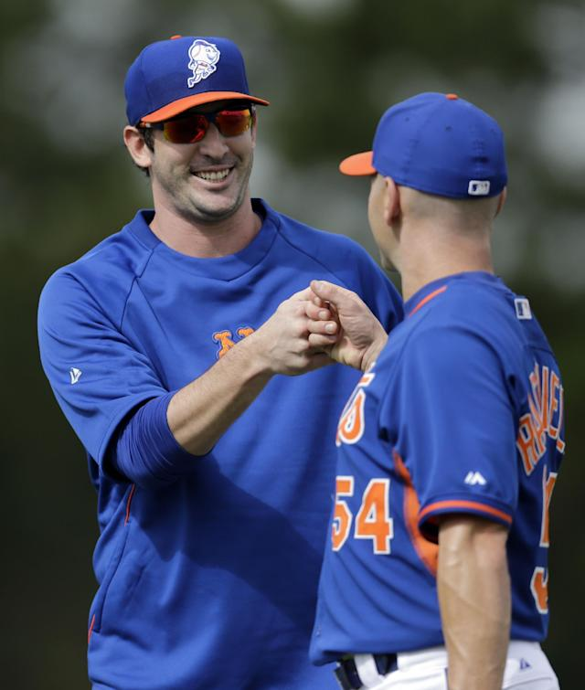 New York Mets pitcher Matt Harvey gets a fist bump from bullpen catcher Dave Racaniello after the two played catch during spring training baseball practice Saturday, Feb. 22, 2014, in Port St. Lucie, Fla. Harvey underwent Tommy John surgery on Oct. 22. (AP Photo/Jeff Roberson)