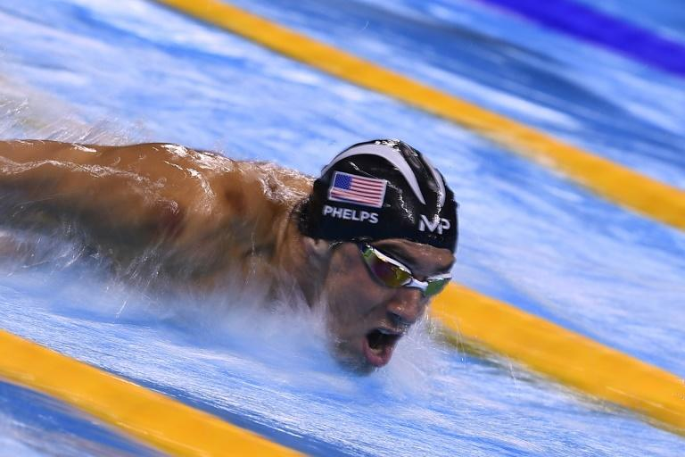 USA's Michael Phelps competes in the Men's 100m Butterfly Semifinal during the swimming event at the Rio 2016 Olympic Games August 11, 2016