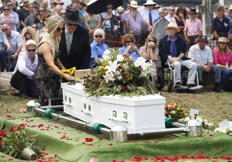 Patrick Salway's wife Renee places a sunflower on the coffin at his funeral. Source: AAP