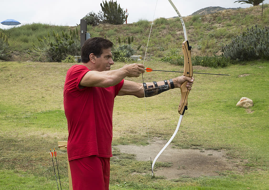 <p>Ferrigno (<em>Incredible Hulk</em>) concentrates on his target during the archery challenge for Team Sci-Fi/Fantasy.<br /><br />(Photo Credit: Kelsey McNeal/ABC) </p>