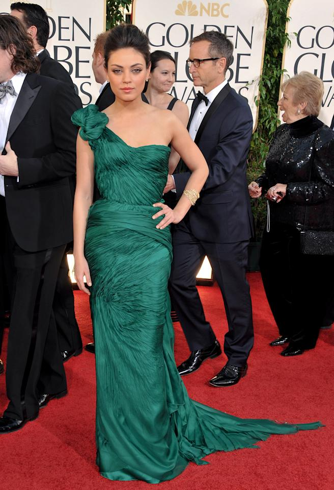 At the 2011 Golden Globes, where she was nominated for her role in the ballet drama, Kunis hit the red carpet in an assymmetrical Vera Wang gown in a flattering shade of green that showed just enough skin. While she didn't take home the trophy, the actress — who wore her hair up in a French twist — landed on many best dressed lists. (1/16/2011)