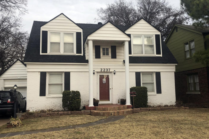"""Elizabeth Warren's onetime family home in Oklahoma City, Monday, Dec. 9, 2019. Warren lived in this home on NW 25th Street in Oklahoma City from when the future Massachusetts senator and Democratic presidential candidate was 11 until she graduated from high school at 16 in 1964. Warren has campaigned for the White House for nearly a year telling audiences nationwide that she grew up on """"ragged edge of the middle class"""" and that her mother dramatically secured a minimum wage job at a nearby Sears at age 50 that kept the family from losing its home after her father had a heart attack -- but her emotional story omits some important context and nuance about her family's financial situation and her mother's employment. (AP Photo/Will Weissert)"""