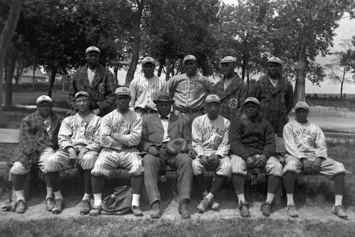 """<span class=""""caption"""">Members of the Chicago American Giants pose for a team portrait in 1914. Rube Foster is seated in the center of the first row wearing a suit.</span> <span class=""""attribution""""><a class=""""link rapid-noclick-resp"""" href=""""https://www.gettyimages.com/detail/news-photo/members-of-the-chicago-american-giants-pose-for-a-team-news-photo/56766731?adppopup=true"""" rel=""""nofollow noopener"""" target=""""_blank"""" data-ylk=""""slk:Diamond Images/Getty Images"""">Diamond Images/Getty Images</a></span>"""