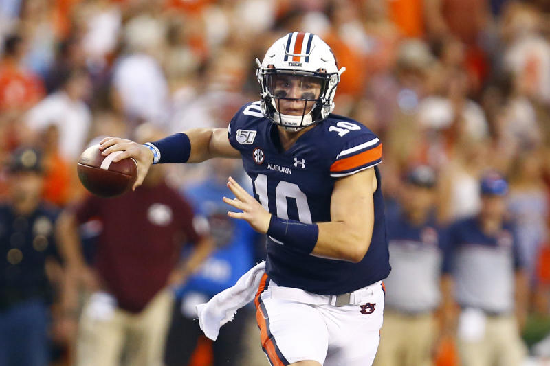 Auburn quarterback Bo Nix (10) rolls out to pass during the first half of an NCAA college football game against Mississippi State, Saturday, Sept. 28, 2019, in Auburn, Ala. (AP Photo/Butch Dill)
