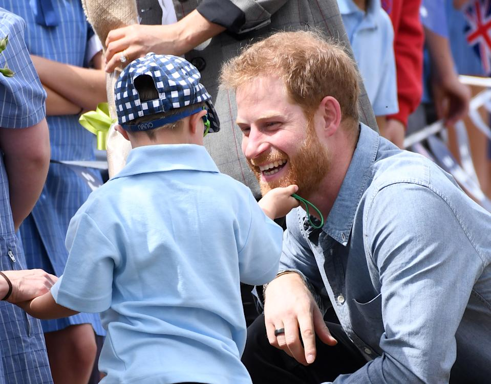 Prince Harry Duke of Sussex and Meghan Duchess of Sussex arrive at Dubbo Airport where they meet Luke Vincent, 5, from Buninyong Public School Kindergarten, New South Wales, Australia. Photo credit should read: Doug Peters/EMPICS