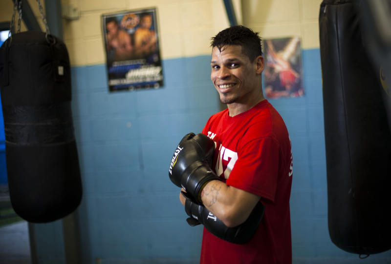 "Boxer Orlando Cruz poses for pictures after a training session at a public gym in San Juan, Puerto Rico, Thursday, Oct. 4, 2012. Describing himself as ""a proud gay man"", Puerto Rican featherweight Orlando Cruz on Thursday became what is believed to be the first pro boxer to come out as openly homosexual while still competing. (AP Photo/Dennis M. Rivera Pichardo)"
