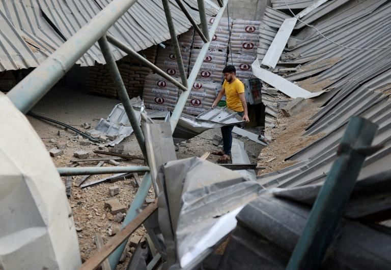 A Palestinian man walks in a factory destroyed by an Israeli air strike in Jabaliya, in the northern Gaza Strip, on May 20, 2021